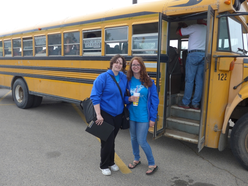 Staffies Alanna and Joanna meeting the delegates on the yellow school bus